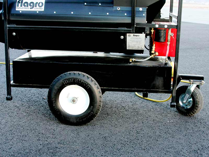 Heavy-duty wheels with flat-free tires, and a 23-gallon fuel tank on the ES300-GSE airport heater.